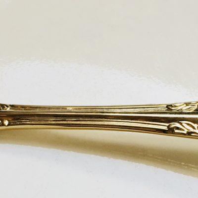 Gold designed sugar ladle